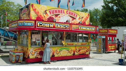 YELLOWSPRINGS, OHIO - MAY 26: Memorial day carnival at Young's Jersey Dairy Farms with person buying something at food truck selling corn dogs and fair food on May 26, 2018 in Yellowsprings, Ohio.