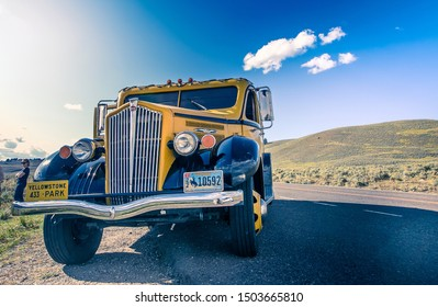 Yellowstone National Park, 8/23/2019: White Motor Company touring vehicle, one of a few restored specifically for Yellowstone, is parked during a stop while on tour.