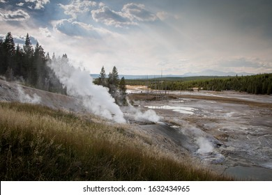Yellowstone National Park landscape. Geysers smoking.