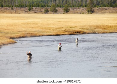 Yellowstone National Park, WY, USA Oct. 1, 2015 3 senior retired men fly fishing the firehole river in Yellowstone National Park.