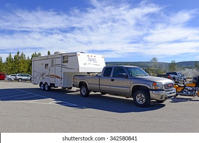 YELLOWSTONE NATIONAL PARK, WYOMING - CIRCA SEPTEMBER 2015. Recreational Vehicles or RVs are an increasingly popular way for tourists to visit National Parks such as volcanically active Yellowstone.