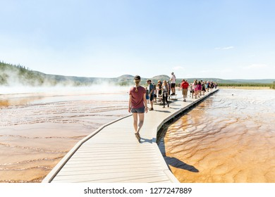 Yellowstone National Park, Wyoming / United States - 7.18.18: Elsa Sylvest walks along side the colorful Grand Prismatic Spring in Yellowstone National Park