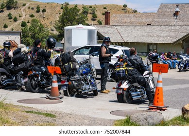 YELLOWSTONE NATIONAL PARK, WYOMING, USA - JULY 17, 2017: Group of bikers visiting Mammoth Hot Springs in Yellowstone National Park.