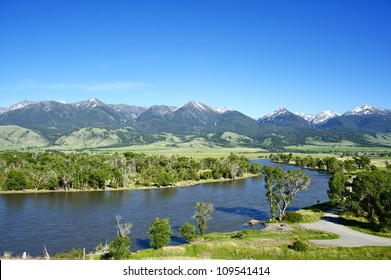 Yellowstone River Near Livingston, Montana, U.S.A. Montana Landscape with Yellowstone River, Mountains Range with Snowy Peaks and Clear Blue Sky. Nature Photo Collection.
