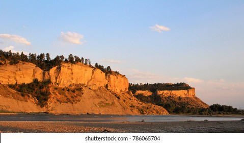 Yellowstone River and Sacrifice Cliff of the Rimrocks at Sunset in Billings Montana during Summer.