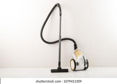 Yellow-white vacuum cleaner white background