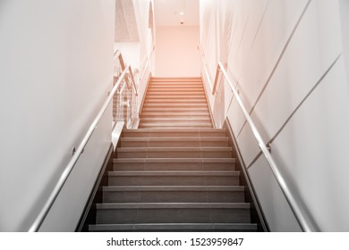 Yeloow and White indoor Concrete Staircase With steel Handrail