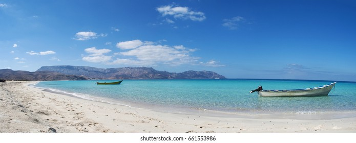 Yemen, 11/02/2013: boats and the rocky coastline of Ras Shuab, Shuab Bay beach, one of the most famous beaches of Socotra, Unesco world heritage site for its biodiversity and endemic peculiarity