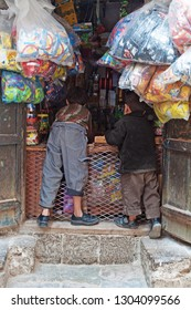 Yemen, Middle East,  05/02/2013: children in front of a grocery store in Suq al-Milh, the salt market of Sana'a, the oldest continuously inhabited and populated city in the world