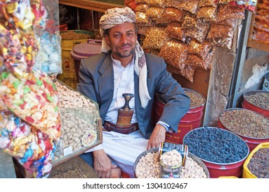 Yemen, Middle East, 05/02/2013: a man selling dried fruit in Suq al-Milh, the salt market of Sana'a, capital of the country, the oldest continuously inhabited and populated city in the world