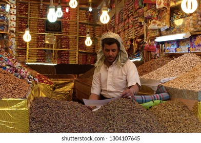 Yemen, Middle East, 05/02/2013: a man selling dried fruit in Suq al-Milh, salt market of Sana'a, the oldest continuously inhabited and populated city in the world, Unesco world heritage site
