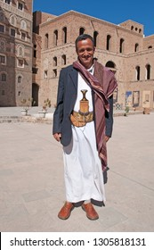 Yemen, Middle East, 05/02/2013: man wearing dishdasha (the traditional yemeni dress) and Janbiya (the yemeni dagger with a short curved blade) at the entrance of the National Museum of Yemen in Sana'a