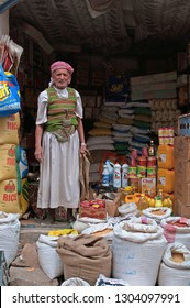 Yemen, Middle East, 05/02/2013: an old man at the entrance of his grocery shop in Suq al-Milh, the salt market of Sana'a, capital of the country, the oldest continuously inhabited city in the world