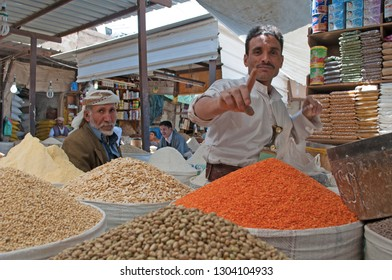 Yemen, Middle East: men selling spices in Suq al-Milh, the salt market of Sana'a, capital of the country, the oldest continuously inhabited and populated city in the world, Unesco world heritage site