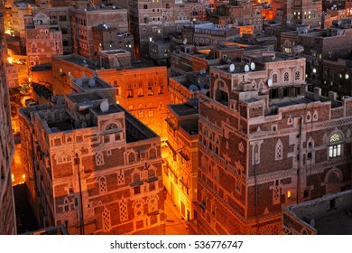 Yemen. Night view of the old city of Sanaa from above. Inhabited for more than 2.500 years at an altitude of 2.200 m, Old City of Sanaa is a UNESCO World Heritage City now destroyed by the civil war