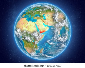 Yemen in red on model of planet Earth with clouds and atmosphere in space. 3D illustration. Elements of this image furnished by NASA.