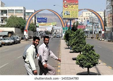 Yemen, Sana'a, August 10,2017, two men cross Az-Zubayri one of the commercial roads of new Sana'a