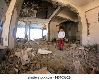 Yemen / Taiz City - May 18 2019: A family living in their house destroyed by the war on the city of Taiz.