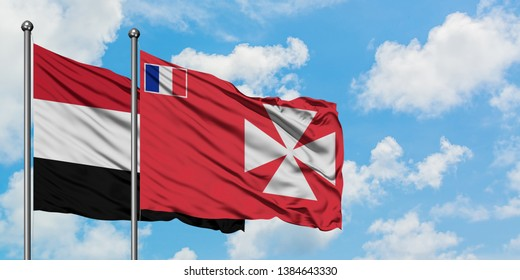 Yemen and Wallis And Futuna flag waving in the wind against white cloudy blue sky together. Diplomacy concept, international relations.