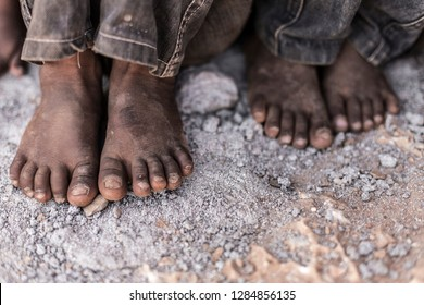 Yemeni barefoot children in dirt and sadness