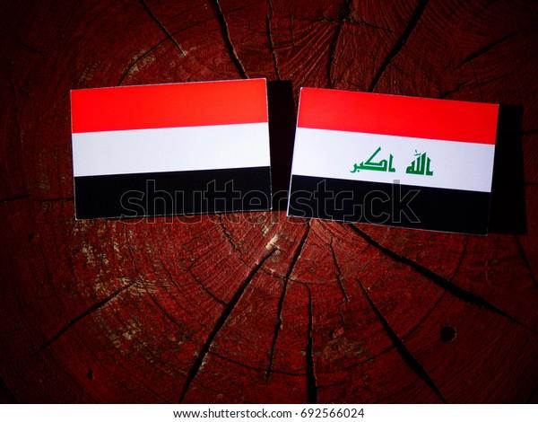 Yemeni flag with Iraqi flag on a tree stump isolated
