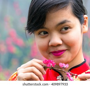 YEN BAI, VIETNAM, February 21, 2016 Ethnic Thai woman, looking cute (name unknown) gardens, peach flowers, bloom in spring, highland Nghia Lo, Yen Bai, Vietnam