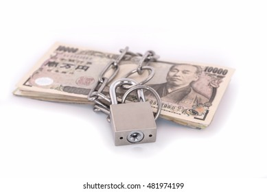 Yen bank notes with a lock and chain. Money stack for safety and investment