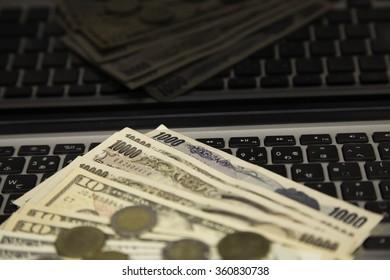 yen , dollar , coin  and notebook