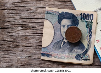 yen notes and yen coins with calendar in save money concept.