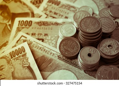 yen notes and yen coins for money concept background