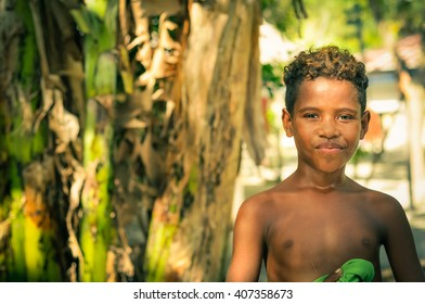 Yenbuba village, Indonesia - June 2015: Young native boy smiles and poses half-naked to photocamera at Yenbuba village at Mansuar Island, Raja Ampat, West Papua, Indonesia. Documentary editorial.