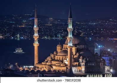 Yeni Cami Mosque (New Mosque) at night in Istanbul, Turkey
