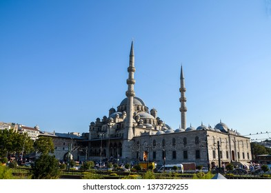 Yeni Cami, New Mosque, in Istanbul. Everyday life in front of the Yeni Cami, New Mosque, in Istanbul. Tourist and locals walking on the square.
