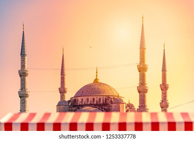 Yeni Cami Ottoman imperial mosque located in the Eminönü quarter of Istanbul, Turkey. Sunset sky in background.