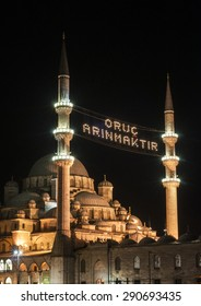 Yenicami Mosque in Eminonu, Istanbul, Turkey. The Mosque is illuminated with MAHYA specially for Ramadan.