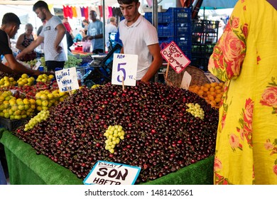 Yenifoca, Foca, Izmir, Turkey - Aug 7th, 2019 - Market stall selling Fresh dark red bing cherries at  weekly farmers market in Yenifoca. Turkey is the World's largest cherry producer.
