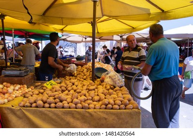 Yenifoca, Foca, Izmir, Turkey - Aug 7th, 2019 - Men buying Potatoes, Vegetables. Weekly  farmers market in Yenifoca.
