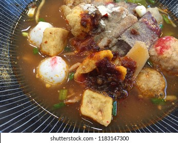 Yen-Ta-Four Authentic Thai-style noodle soup with fishballs, crispy wonton skin, and special homemade red sauce.