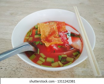 Yen-Ta-Four, sea food soup with or with out noodles , vegetable and tomato sauce, Thai-style noodle soup with fishballs, crispy wonton skin, and special homemade red sauce, Pink Noodle Soup