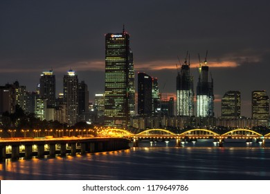 Yeouido island and hangang bridge illuminated at night. The view of famous 63 building and city lights reflecting on the han river. Taken in seoul, south korea. Taken on Septepmber 14 2018