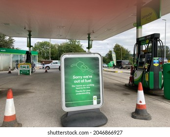 Yeovil, Somerset, England - September 24 2021: BP Petrol station forecourt with Sorry We Are Out of Fuel sign,  due to the lack of HGV drivers