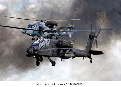 Yeovilton, Somerset / UK - July 2 2016: AgustaWestland Apache AH1 & Wildcat HMA2 (ZZ510) Helicopters at the RNAS Yeovilton International Air Day 2016, Somerset, United Kingdom.