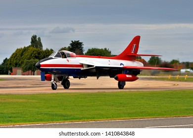 Yeovilton, Somerset / UK - July 4 2008: Skyblue Aviation's ex- Boscombe Down, Empire Test Pilots School, red, white and blue Hawker Hunter FGA.9 XE601/G-ETPS pictured taxying at the RNAS Yeovilton