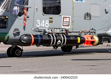 Yeovilton, Somerset / UK - July 7 2007: An inert round Sting Ray Anti-Submarine Warfare Torpedo mounted to an 702 Naval Air Squadron Royal Navy HMA.8 Lynx Helicopter, ZF557/348.
