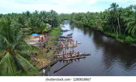 yepem village with their canoe, asmat, indonesia.