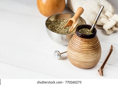 yerba mate with accessories on white wooden background