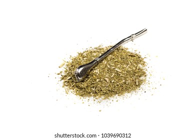 Yerba Mate Tea powder on white background. Dried yerba mate tea with bombilla straw.