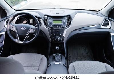 Yerevan, Armenia - 07 July 2019. Black and grey interior of modern SUV Hyundai Santa Fe with automatic transmission.