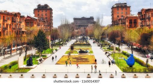 Yerevan, Armenia - 09 April, 2017: People enjoy a warm autumn evening at the Cascade, a giant stairway in Yerevan, Armenia. It was designed by architects Jim Torosyan, Aslan Mkhitaryan, Sargis Gurzady