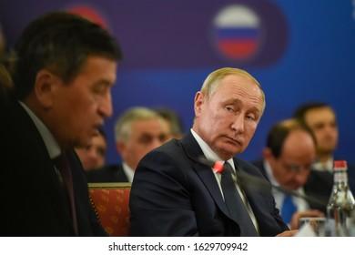 YEREVAN, ARMENIA - 1 OCTOBER 2019: Russian President Vladimir Putin listen to president of Kyrgyzstan Sooronbay Jeenbekov during  meeting of the Supreme Eurasian Economic Council in Yerevan, Armenia.